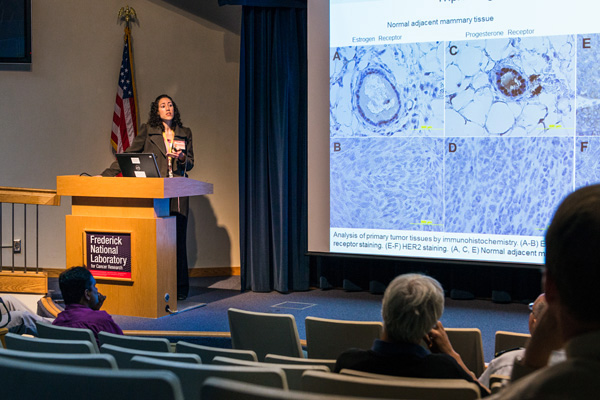 Nadia P. Castro, NCI, presenting at the Scientific Symposium, sponsored by the National Interagency Confederation for Biological Research, on May 4.