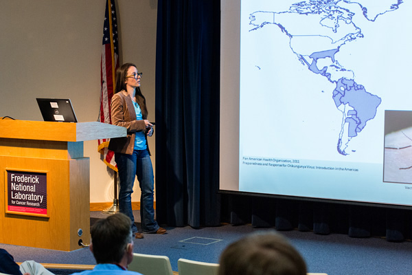 Valerie Huse, USAMRIID, presenting at the Scientific Symposium, sponsored by the National Interagency Confederation for Biological Research, on May 4.