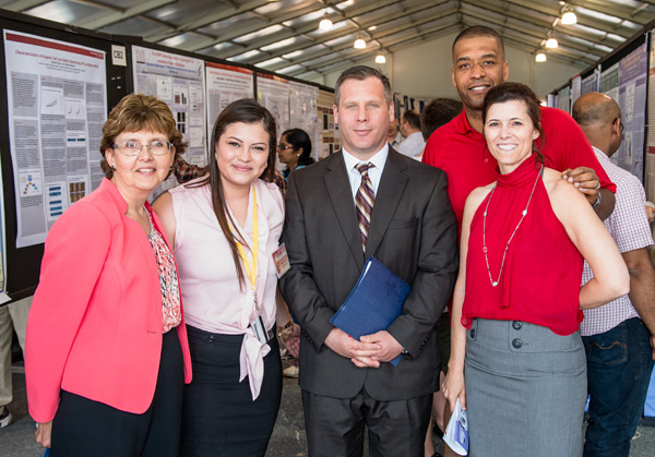 (From left) Terry Alban, superintendent, FCPS; Mylen Perez, NCI at Frederick student intern; Mike Markoe, deputy superintendent, FCPS; Jim Cherry, scientific program director, NCI at Frederick; and Marsha Nelson-Duncan, education specialist, NCI at Frederick.