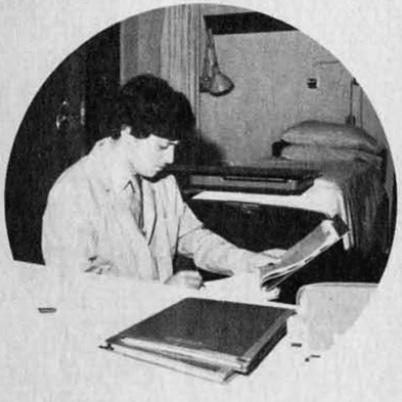 An unknown BRMP scientist reviews documents during the 1980s. (NCI BRMP Patient Guide)