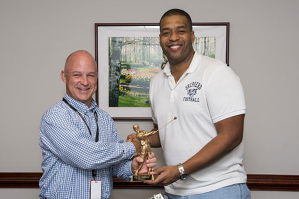 Craig Hayn (left) receives the most valuable player award for the NCI Team from Jim Cherry, one of the team captains. Photo by Joe Meyer, Staff Photographer.