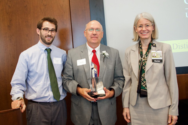 Distinguished alumni from left to right, Josh Bleicher, University of Iowa Medical Student; Craig Reynolds, Award for Achievement; and Debra Schwinn, dean, University of Iowa Carver College of Medicine.