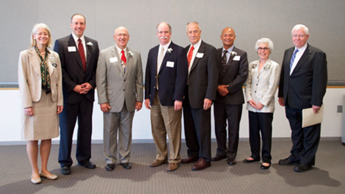 Distinguished alumni from left to right, Debra Schwinn, dean, University of Iowa Carver College of Medicine; Chris Cooper, Award for Achievement; Craig Reynolds, Award for Achievement; David Warner, Award for Achievement; G. Patrick Kealey, Award for Service; Andrew Doan, Award for Early Career Achievement; Jesse Joad, Award for Achievement; and Jean Robillard, vice president for Medical Affairs, University of Iowa.