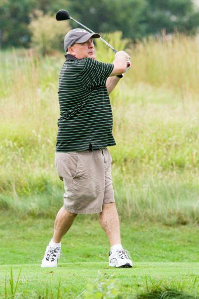 Rich Tucker takes a swing.