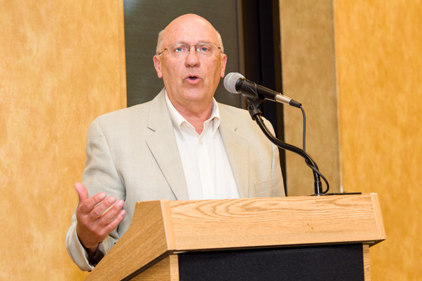 Associate Director Craig Reynolds, Ph.D., NCI, presents at the Spring Research Festival awards ceremony.