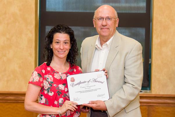 Christina Bergamaschi receives her award for an Outstanding Poster from NCI Associate Director Craig Reynolds, Ph.D.