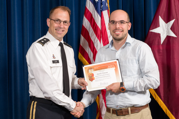 Dionysios (Dennis) Watson accepts certificate from Maj. Gen. Brian Lein, commanding general, USAMRMC, for Outstanding Presentation at the NICBR Scientific Symposium.