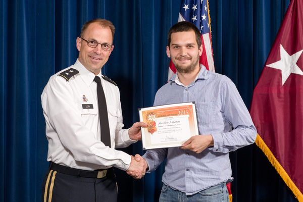 Matthew Anderson accepts certificate from Maj. Gen. Brian Lein, commanding general, USAMRMC, for Outstanding Poster, Developmental and Cell Biology.
