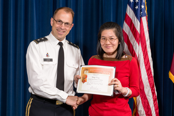 Yang Feng accepts certificate from Maj. Gen. Brian Lein, commanding general, USAMRMC, for Outstanding Poster, Therapeutics, Vaccines, and Drug Delivery.