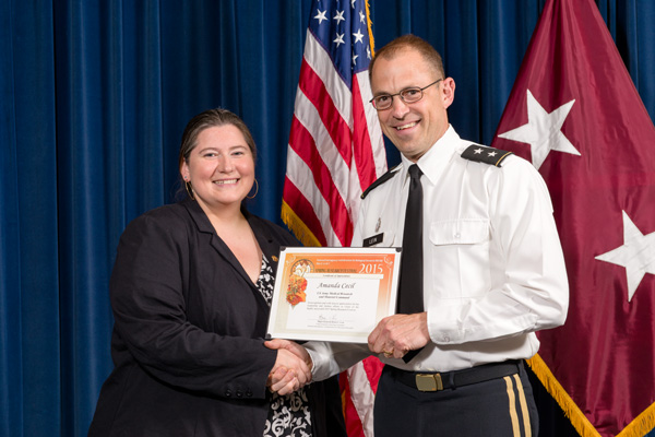 Amanda Cecil, Spring Research Festival chair, accepts certificate of appreciation from Maj. Gen. Brian Lein, commanding general, USAMRMC.