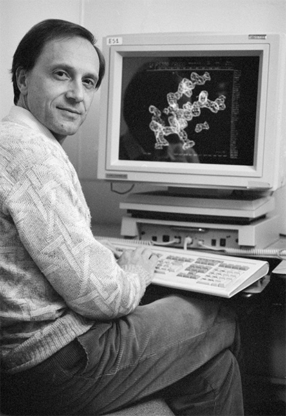 Wlodawer examines a molecular structure on a computer at the NCI-Frederick Cancer Research and Development Center in December 1990. (Photo from SPGM archive)