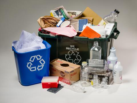 Photo of single-stream recycling bins and items.
