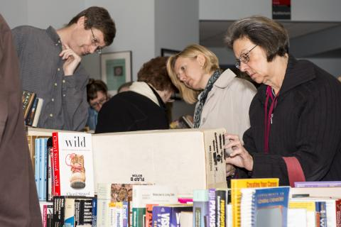 People searching through books