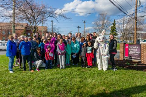 The Bunny Hop 4k participants gathered for a group photo with the Easter Bunny.
