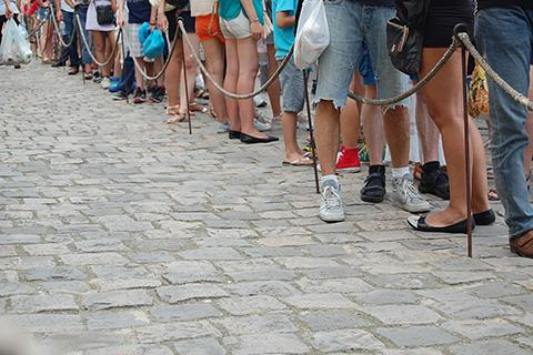 Photo of people standing in line