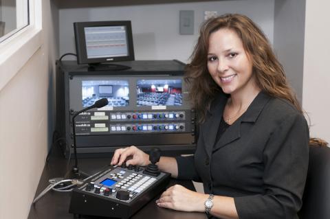 Woman at monitors.