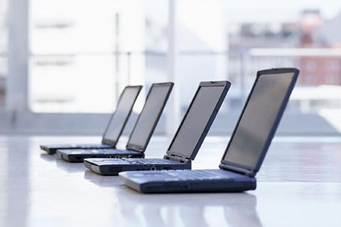 Laptops sitting on a table.