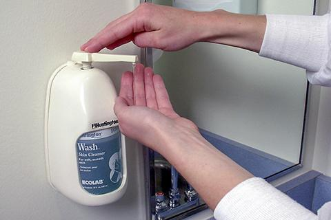 A person soaping up to wash their hands