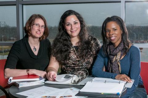 Group photo of three women.