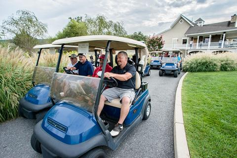 Golfers in golf carts.