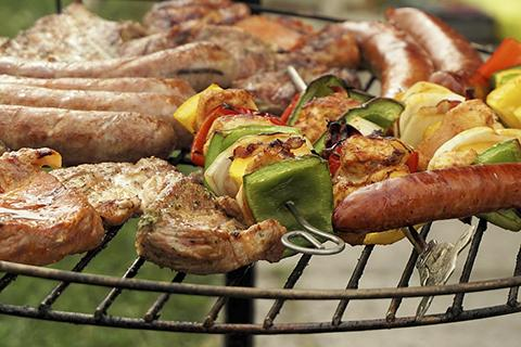Meat and vegetables on the grill.