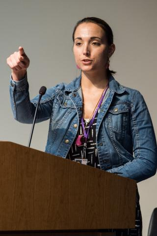 Amanda Corbel at a lecturn.