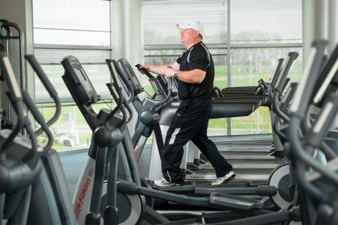 Shawn Kelly exercises on an elliptical machine at the ATRF