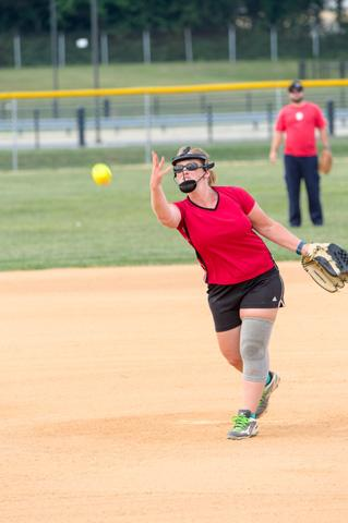 A pitch is thrown at the 4th Annual Softball Mini Tournament.