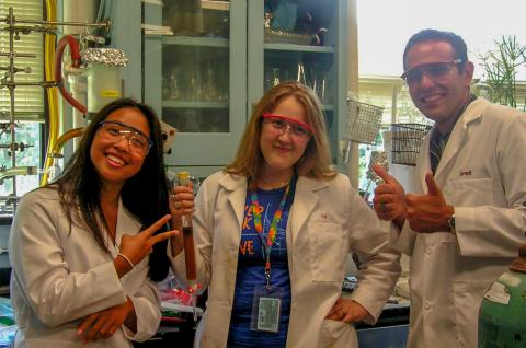 Three student interns in the lab.