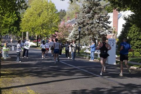 Festival staff hand out water at the 12th mile marker during the Frederick Running Festival.