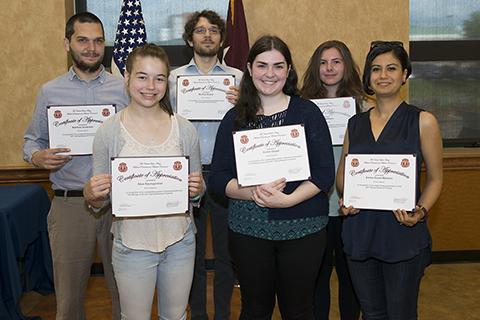 A group of NCI researchers posing with their awards