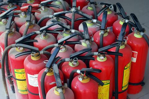A collection of fire extinguishers.