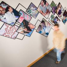 The overlapping images represent the collaborative battle against cancer and AIDS.