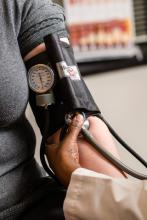 Woman having blood pressure checked.