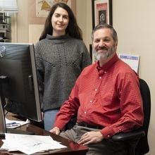Dr. Dennis Klinman stands with Begum Horuluoglu in their NCI at Frederick laboratory