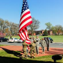 Soldiers saluting the flag.