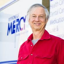 Michael Dean, Pd.D., volunteering with Mission of Mercy as a Spanish language interpreter.