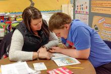 he author's son, Harrison, works with his teacher, Jenna Clifton