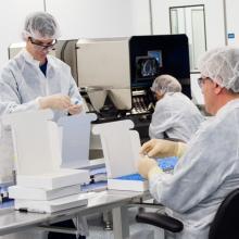 Scientists filling vials.