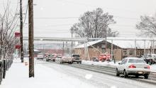 cars leaving Fort Detrick in a snow storm