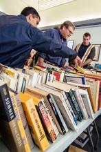People looking through books