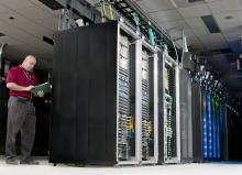 A man with network racks.