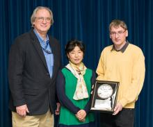 Three scientists at award presentation.