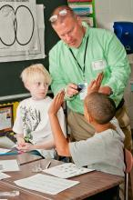 Gary Krauss working with elementary school students