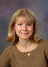 Portrait of Debbie Morrison.