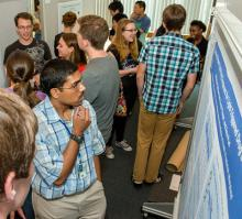 People viewing scientific posters.