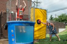 Man being dunked in dunk tank.