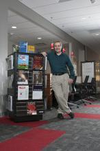 Man standing in resource center.