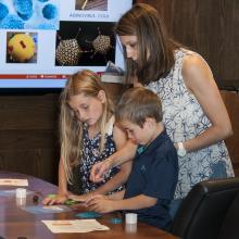 Take Your Child to Work Day event involving dry ice and a blowtorch.